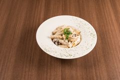 Italian pasta with mushrooms and gorgonzola sausages Stock Images