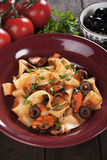 Italian pasta with mussels and olives Royalty Free Stock Photography
