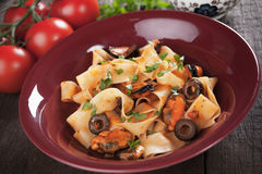 Italian pasta with mussels and olives Stock Images