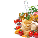 Italian pasta nest, cherry tomatoes, spices, olive oil,  Royalty Free Stock Image