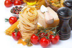 Italian pasta nests, vegetables and parmesan cheese Royalty Free Stock Image
