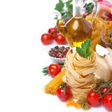 Italian pasta nests, vegetables, spices, olive oil, isolated Stock Images