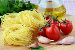 Italian pasta, olive oil and tomatoes Stock Photos