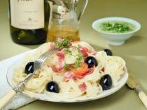 Italian Pasta with Olives, Hamon and Pesto Sauce stock photos