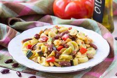 Italian pasta orecchiette with stew of vegetables and beans Royalty Free Stock Photos