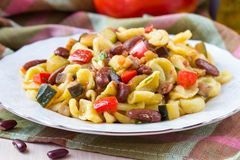 Italian pasta orecchiette with stew of vegetables and beans Stock Photography