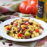Italian pasta orecchiette with stew of vegetables and beans Stock Images