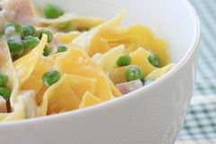 Italian pasta with peas, ricotta and backed ham Stock Photography
