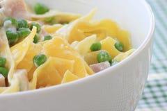 Italian pasta with peas, ricotta and backed ham Stock Photography