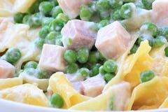 Italian pasta with peas, ricotta and backed ham Royalty Free Stock Photo