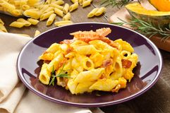 Italian pasta, penne with bacon and pumpkin Stock Photo