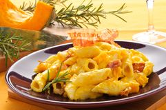 Italian pasta, penne with bacon and pumpkin Stock Photography