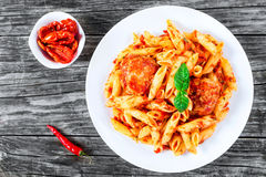 Italian Pasta Penne with noisettes and Sun-Dried Tomato Pesto. Close-up Royalty Free Stock Images