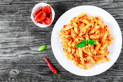 Italian Pasta Penne with Sun-Dried Tomato Pesto, top view Royalty Free Stock Images