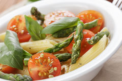 Italian pasta penne with tomatoes and asparagus Stock Images