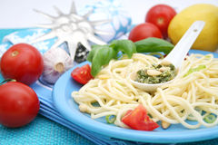 Italian Pasta with pesto Stock Images