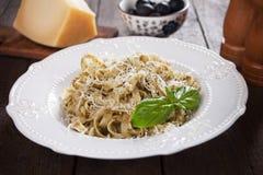Italian pasta with pesto genovese. Italian pappardelle pasta with pesto genovese, basil and parmesan cheese Royalty Free Stock Photography