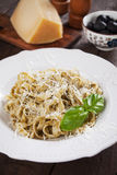 Italian pasta with pesto genovese. Italian pappardelle pasta with pesto genovese, basil and parmesan cheese Royalty Free Stock Images