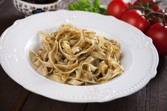 Italian pasta with pesto genovese. Italian pappardelle pasta with pesto genovese served in a plate Stock Photos