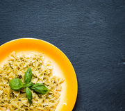 Italian pasta with pesto sauce made with basil leaf. S, pine nuts, fresh garlic and olive oil over an old wood background, top view Royalty Free Stock Photos