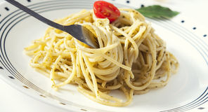 Italian pasta. A plate of italian pasta with garlic and pesto Stock Image