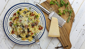 Italian Pasta Plate with Green and Black Olives, Parmesan Chess Royalty Free Stock Photography