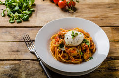 Italian pasta with poached egg Royalty Free Stock Photo