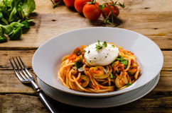 Italian pasta with poached egg Stock Image