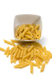 Italian pasta in a porcelain bowl on white background Stock Images