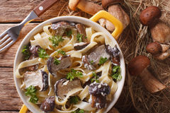 Italian pasta with porcini mushrooms and cream sauce close-up. H Stock Photo