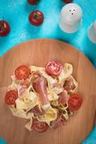 Italian pasta with prosciutto. Italian pasta with cheese sauce and slices of prosciutto smoked ham Royalty Free Stock Photography