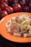 Italian pasta with prosciutto Stock Images