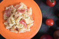 Italian pasta with prosciutto Stock Photo