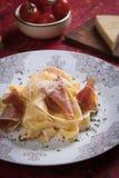 Italian pasta with prosciutto. Italian pasta with cheese sauce and slices of prosciutto smoked ham Stock Photo