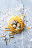 Italian pasta with quail eggs for Easter Royalty Free Stock Images