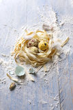 Italian pasta with quail eggs for Easter Royalty Free Stock Image