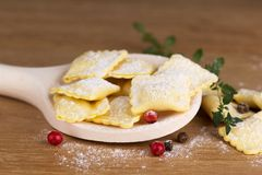 Italian pasta, ravioli with flour eggs and greens Stock Image