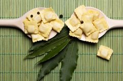 Italian pasta, ravioli with flour eggs and greens. Italian pasta, ravioli with flour eggs, herbs on a spoon Stock Photo