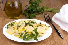 Italian pasta, ravioli with parsley and olive oil. Italian pasta, ravioli with parsley, olive oil and flatware Stock Photos