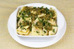 Italian pasta, ravioli with parsley and pesto. Italian pasta, ravioli with parsley, olive oil and pesto sauce Stock Images