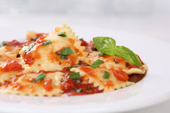 Italian Pasta Ravioli with tomato sauce noodles meal with basil Stock Photos