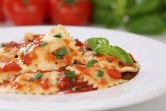 Italian Pasta Ravioli with tomatoes and basil meal Stock Photo