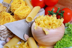 Italian pasta, red tomatoes and peppers. Royalty Free Stock Image