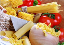 Italian pasta, red tomatoes and peppers. Stock Image