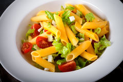 Italian Pasta salad. Served in a white plate Stock Image