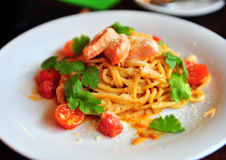 Italian pasta with salmon and cherry Royalty Free Stock Photo
