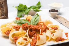 Italian pasta and sauce with meal Stock Images