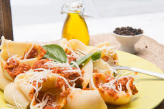 Italian pasta and sauce with meal Royalty Free Stock Photography