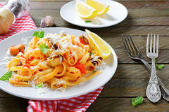 Italian pasta with seafood and cheese on a plate Royalty Free Stock Images