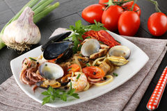 Italian pasta with seafood, mussels, clams, shrimp and squid Stock Photo